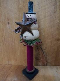 Snowman atop bobbin